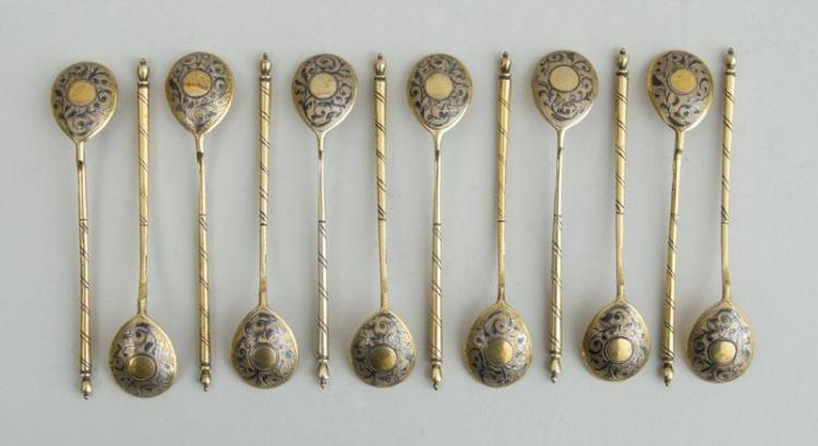 SET OF TWELVE RUSSIAN GILDED SILVER AND NIELLO TEASPOONS