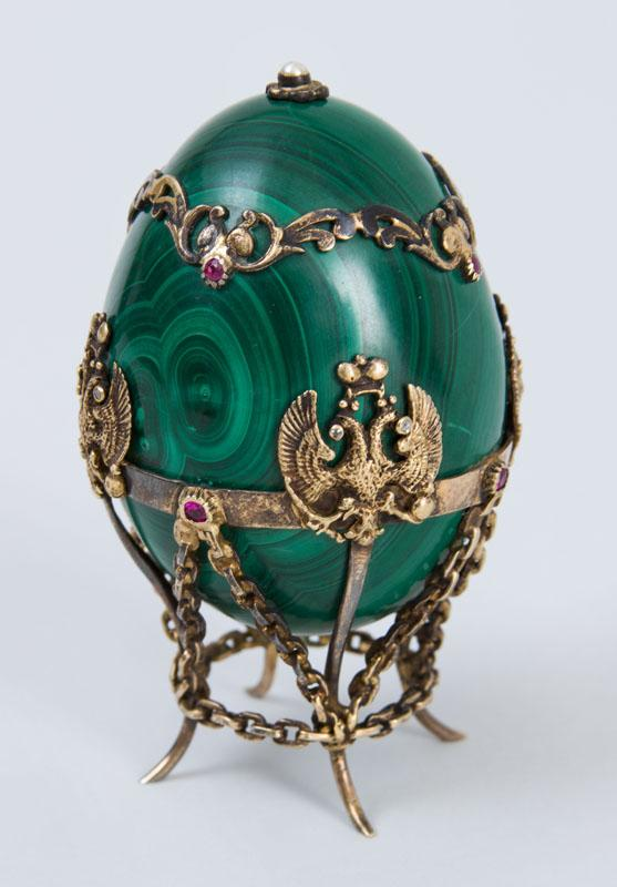 RUSSIAN SILVER-GILT-MOUNTED MALACHITE EGG, IN THE MANNER OF FABERGÉ