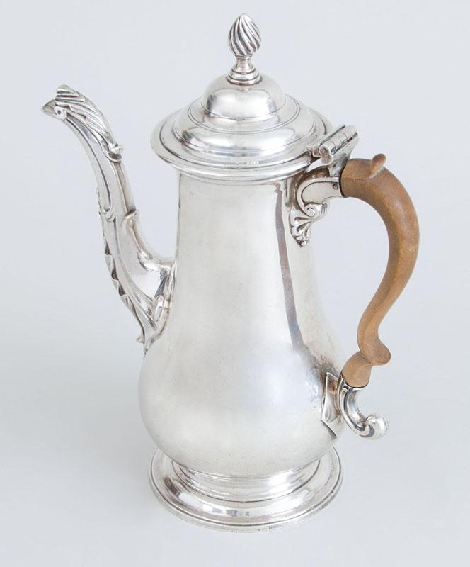 GEORGE II CRESTED SILVER SMALL COFFEE POT AND A GEORGE III PEAR-FORM FOOTED COFFEE POT