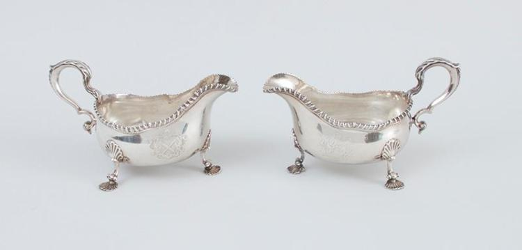PAIR OF EARLY GEORGE III ARMORIAL SILVER TRIPOD SAUCE BOATS, OF AMERICAN INTEREST, WITH LATER INSCRIPTIONS