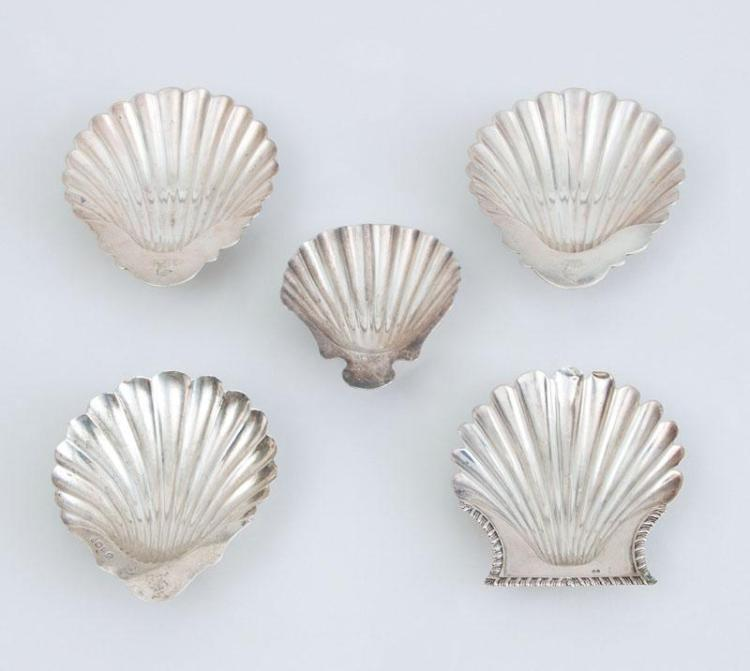 FOUR ENGLISH SILVER BUTTER SHELLS AND A SILVER-PLATED BUTTER SHELLS