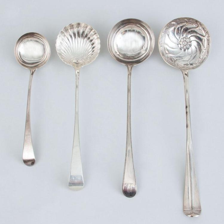 THREE GEORGE III SILVER PUNCH LADLES AND A GEORGE III SILVER SAUCE LADLE
