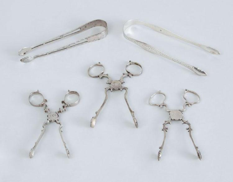THREE PAIRS OF GEORGE III SILVER SCISSOR-FORM SUGAR NIPS AND TWO PAIRS OF TONGS