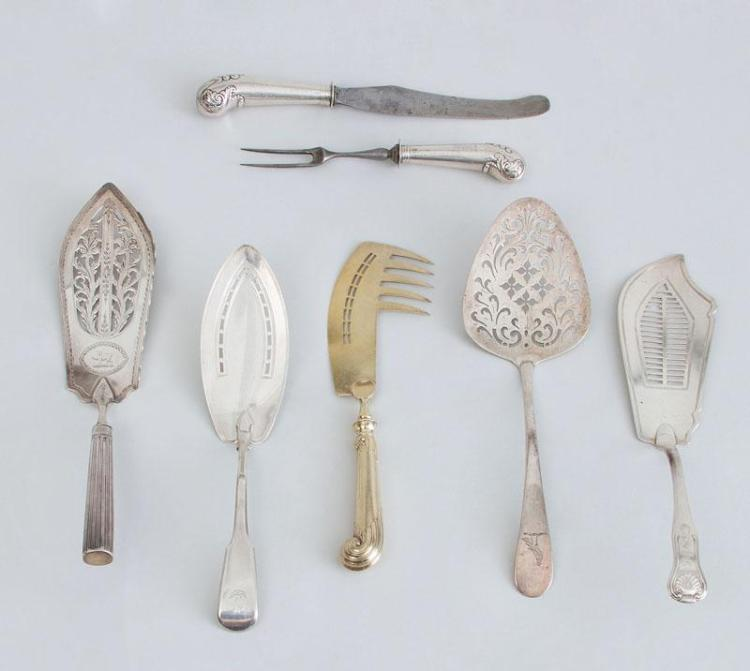 THREE GEORGE III SILVER FISH SLICES, AN IRISH SERVER AND THREE PISTOL-HANDLED SERVING PIECES