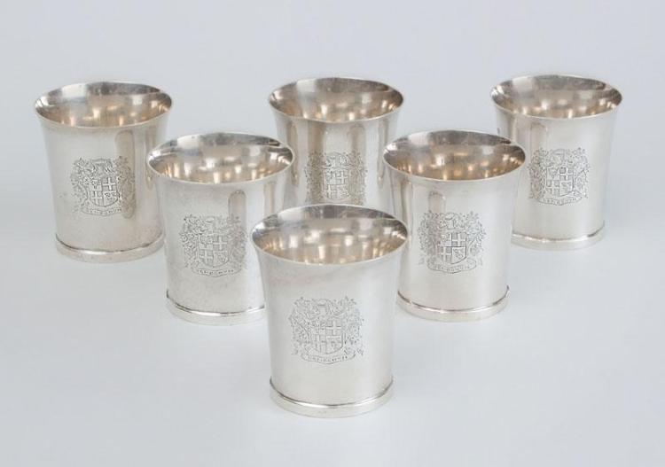 ASSEMBLED SET OF SIX GEORGE III SILVER BEAKERS WITH LATER MATCHING ARMORIALS