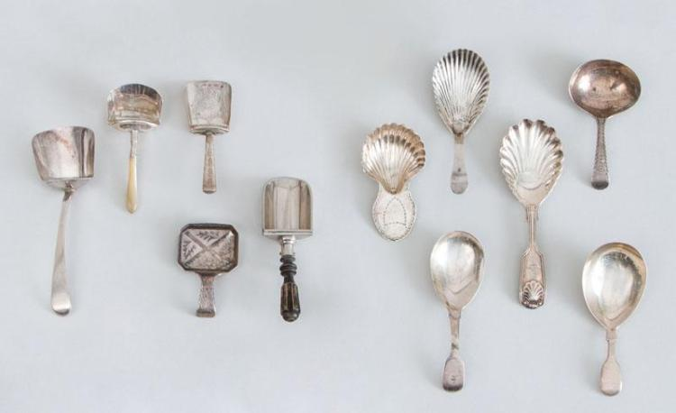 GROUP OF TEN GEORGIAN AND VICTORIAN SILVER CADDY SPOONS AND A SILVER-PLATED SPOON