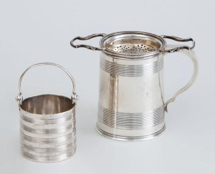 VICTORIAN MONOGRAMMED SILVER MUG, A GEORGE III SILVER PAIL AND A SILVER STRAINER