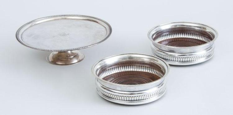 PAIR OF ENGLISH SILVER-PLATED COASTERS AND A SILVER-PLATED CRESTED AND STEMMED PLATE