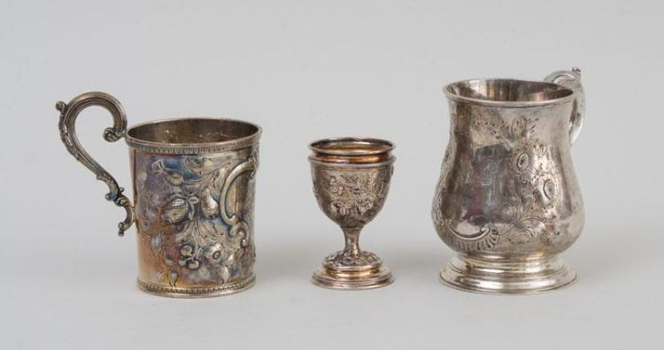 TWO REPOUSSÉ PRESENTATION SILVER MUGS AND A SILVER EGG CUP