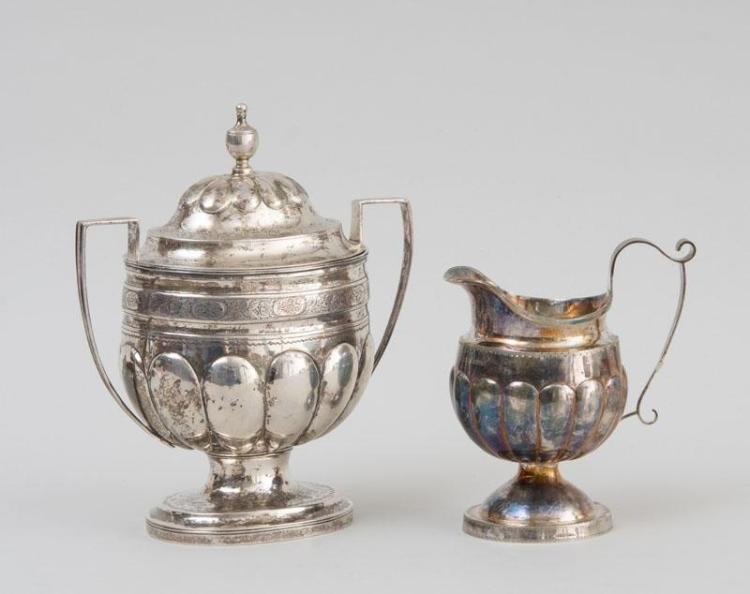 AMERICAN SILVER SUGAR BOWL AND COVER AND A CREAMWARE JUG