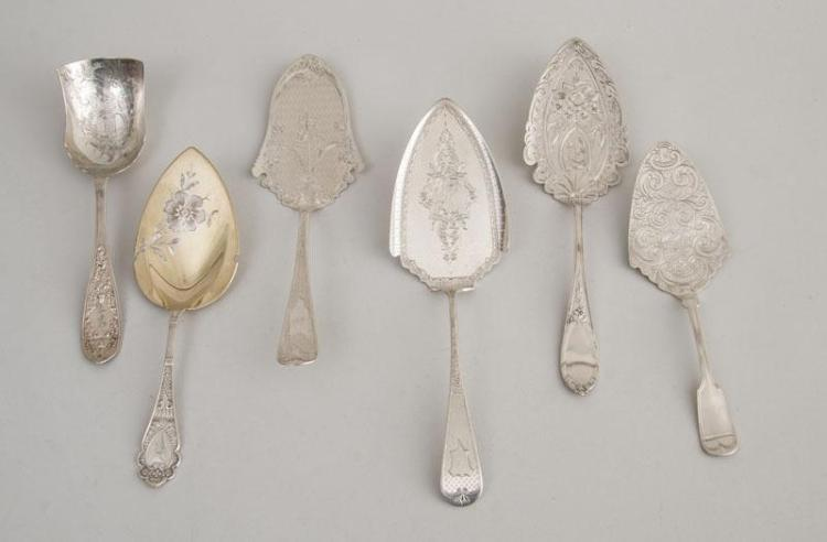 FIVE AMERICAN SILVER PASTRY SERVERS WITH ENGRAVED SURFACE AND A SILVER ICE CREAM SHOVEL
