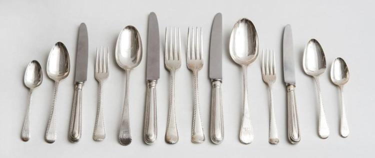 GEORGE III AND LATER ENGLISH CRESTED SILVER ASSEMBLED EIGHTY-THREE-PIECE PART FLATWARE SERVICE IN THE