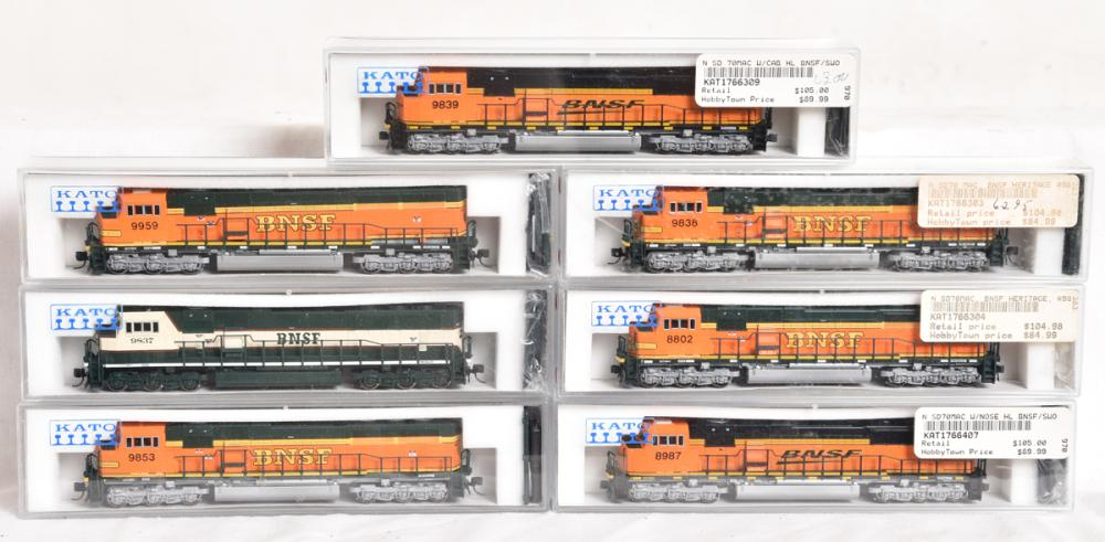Seven Kato N Scale BNSF SD70MAC diesel locomotives 176-6304, 6302, 6407, 6303, 6401, 6402, and 6309