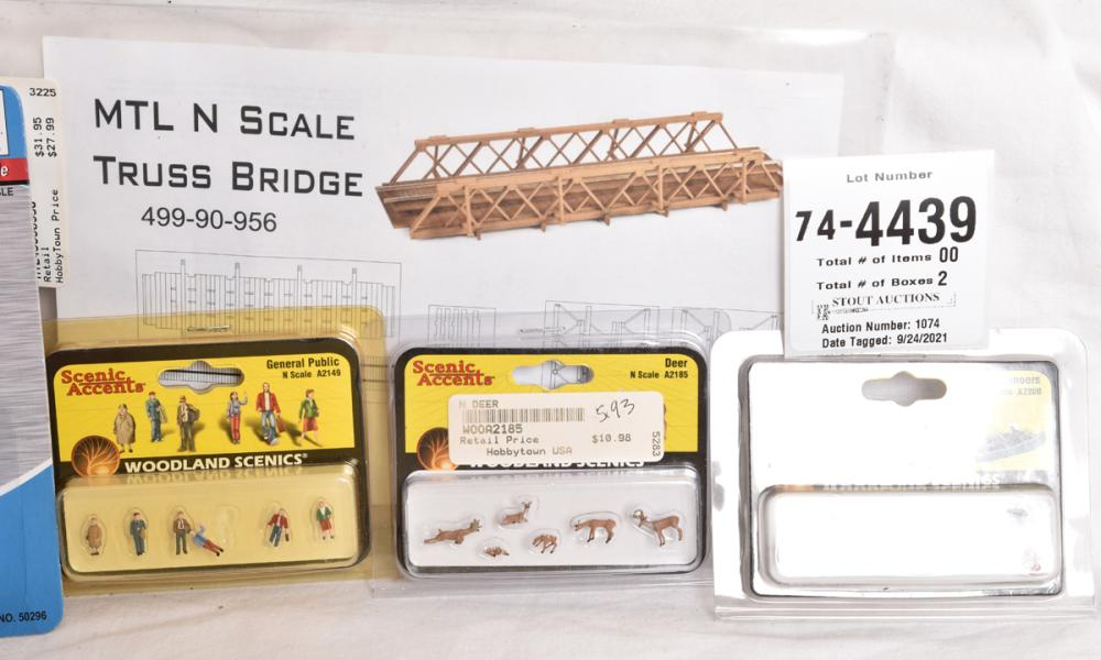 Large group of N scale trees, detail parts, brass detail parts, wooden detail laser cut parts, and more