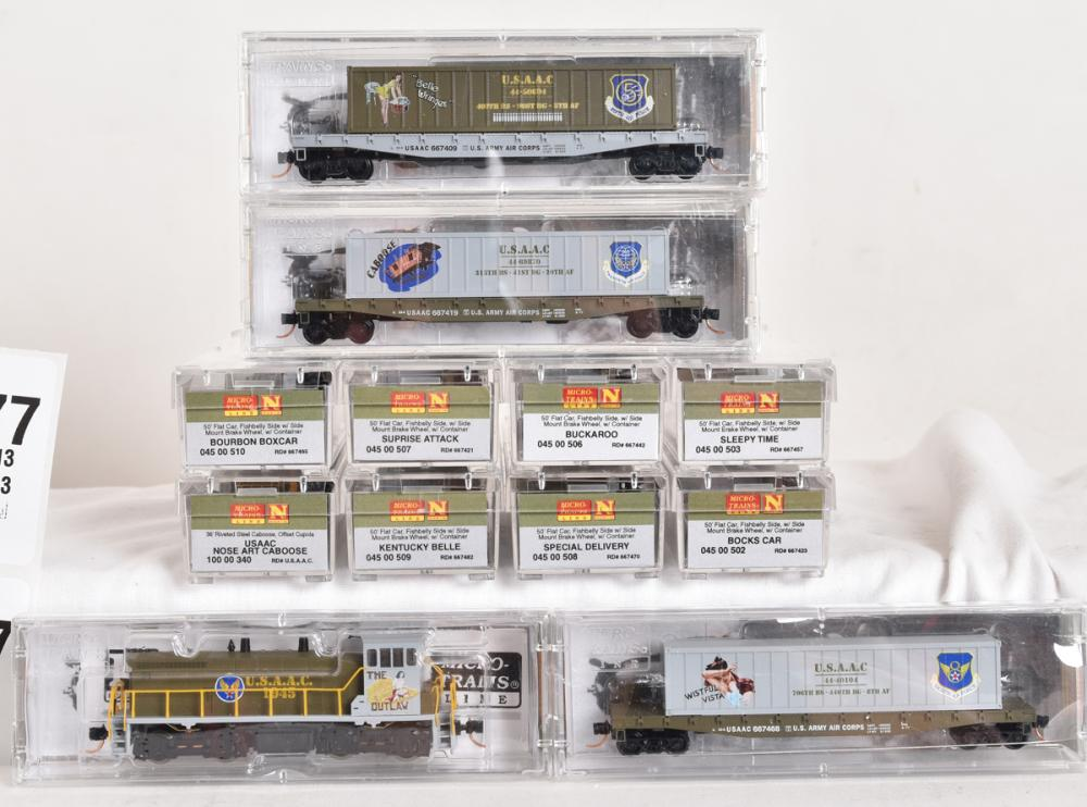 Micro Trains N scale United States Army Air Corps nose are locomotive, caboose, and eleven flat cars with nose art containers