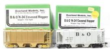 Overland Models HO brass pair of B&O OMI-1390 N-34 covered hoppers - one painted one unpainted