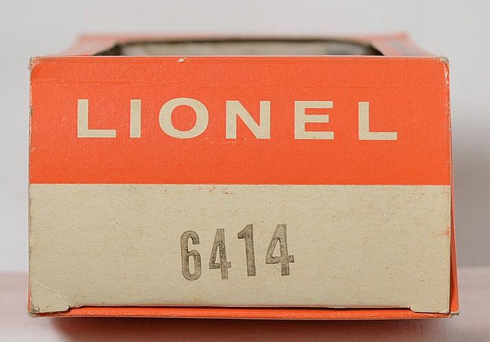 Unrun Lionel Postwar O gauge 6414 autoloader with yellow