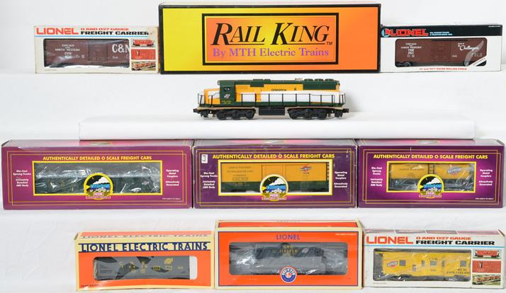 Railking, Lionel, and MTH C&NW SD60 locomotive and freight cars