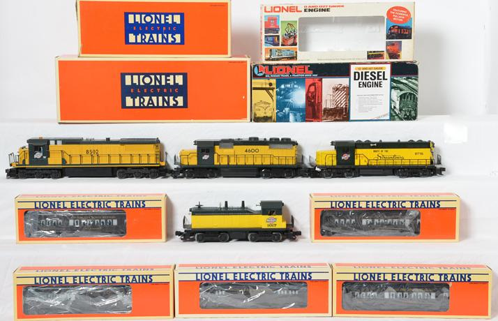4 Lionel Chicago and Northwestern locomotives and 5 baby Madison passenger cars