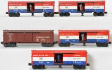 Four Lionel postwar 3428 US Mail cars and one tuscan 6468X B&O boxcar