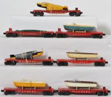 Great Lionel lot of flatcars, boats, Christmas, airplanes