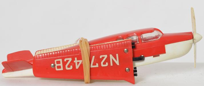 Lionel Postwar red and white beechcraft bonanza airplane for 6500 flat car