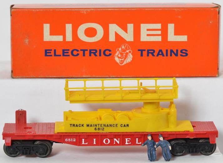 Unrun Lionel 6812 track maintenance car in box, yellow platform and base