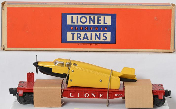 Lionel 6800 flat with black and yellow beechcraft bonanza plane
