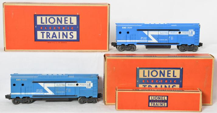 Two Lionel 3530 GM operating generator cars in original boxes