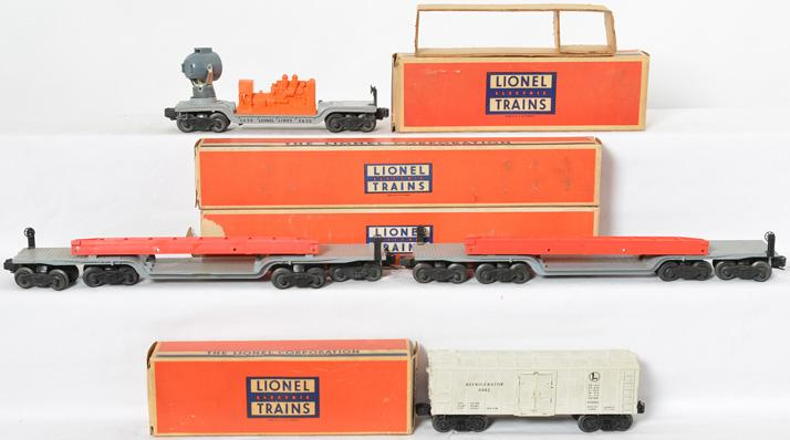 4 Lionel freight cars with original boxes 6418, 6418, 6482, 3620