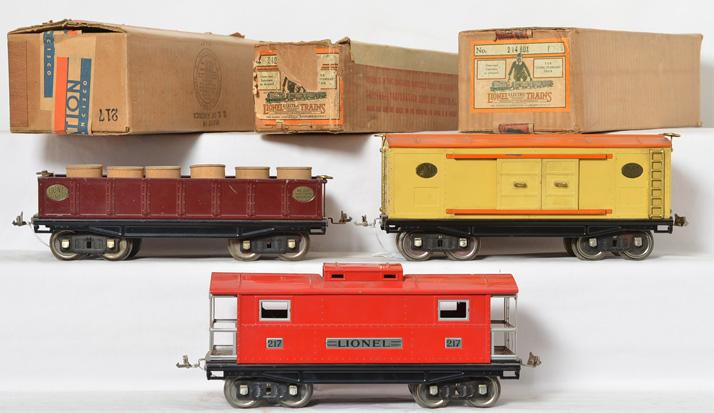 3 Lionel standard gauge cars with original boxes 217 caboose, 212 gondola, 214 boxcar