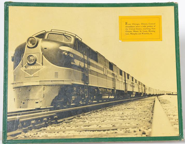 Illinois Central Railroad advertising display featuring E-7 EMD locomotive