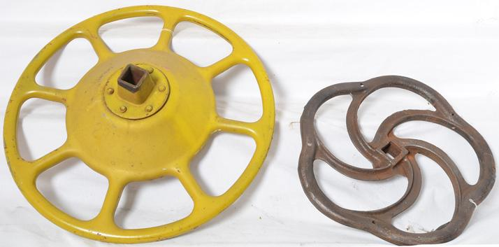 Two railroad freight car brake wheels