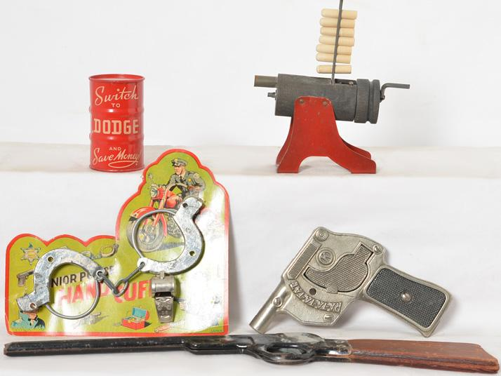 vintage toys including toy rifle, Rat-ta-tat machine gun, Junior Police Handcuffs