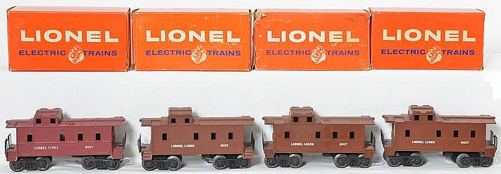 Four Lionel 6017 cabooses with original boxes