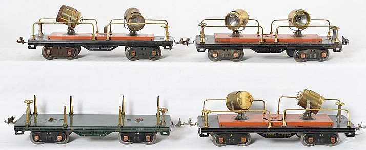 4 Lionel standard gauge cars three 520 searchlight cars and 511 flat