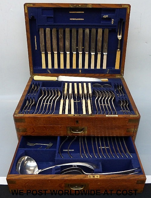An oak four-section fitted canteen of cutlery by