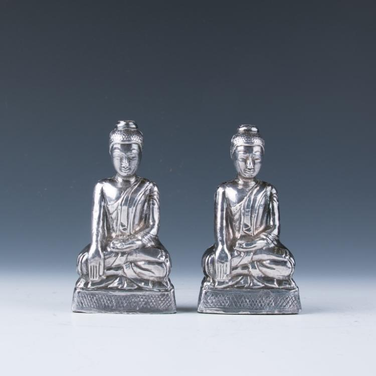 A Pair of Silver Figures of Buddha