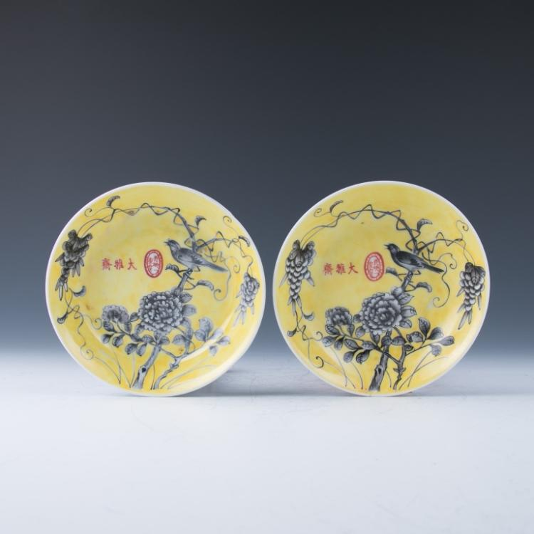 A Pair of Yellow Ground Grisaille-Enameled Dishes