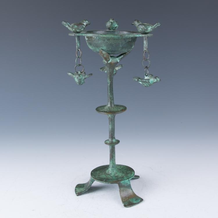 A Bronze Birds Candle Holder