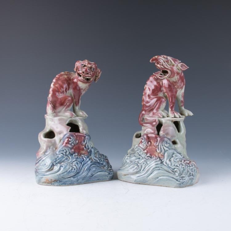 A Pair of Red Glazed Porcelain Beasts