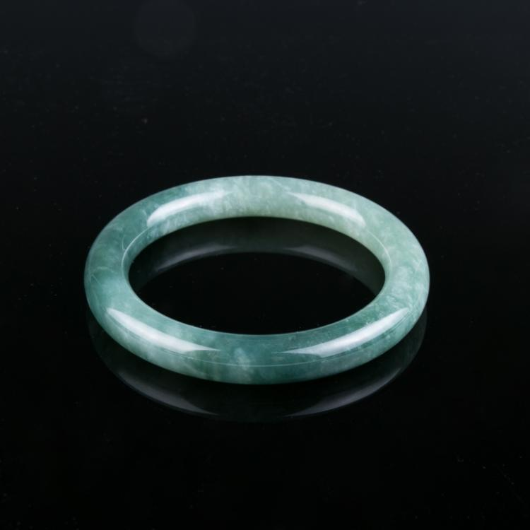 A Spinach Green Jadeite Bangle