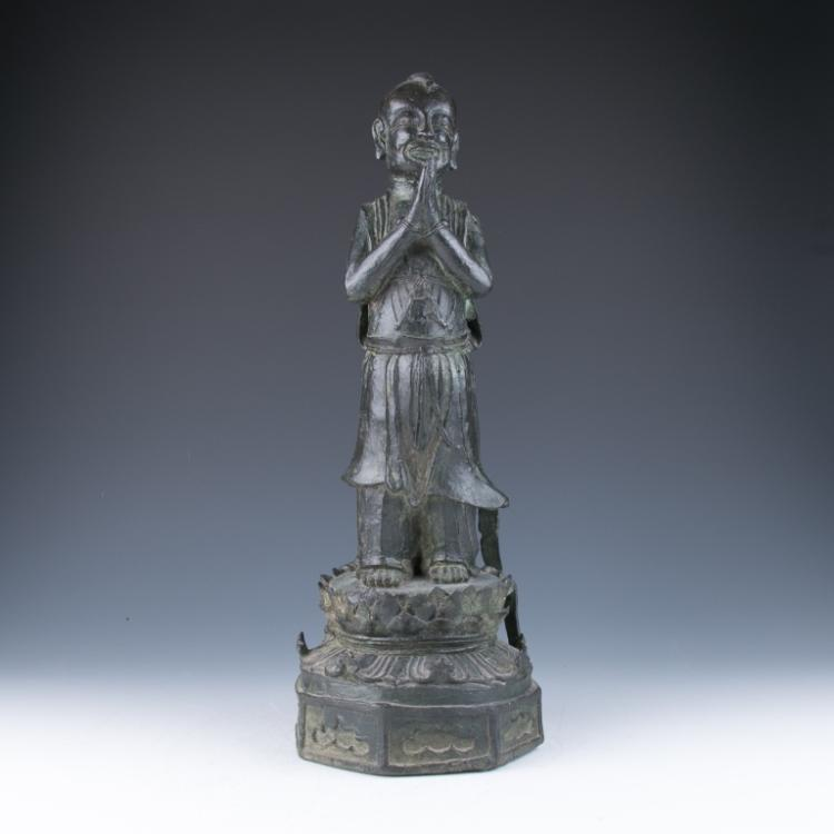 A Large Bronze Figure of an Acolyte, 16th/17th