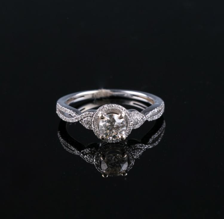 A Stamped 14K White Gold Diamond Ring