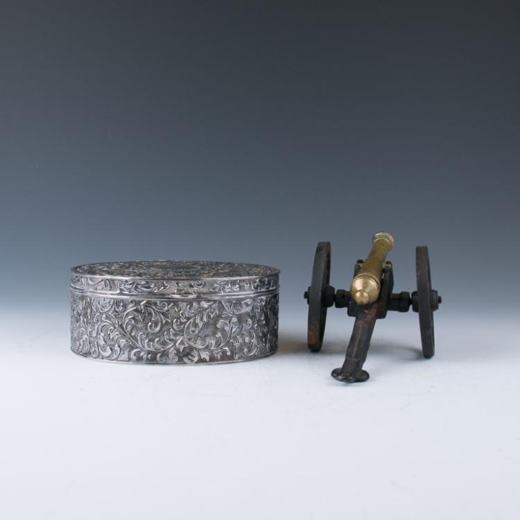 A Silver Jewelry Box / A Bronze Cannon