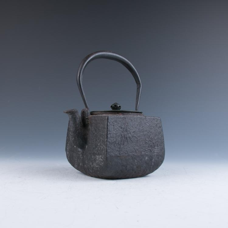 An Old Japanese Iron Teapot
