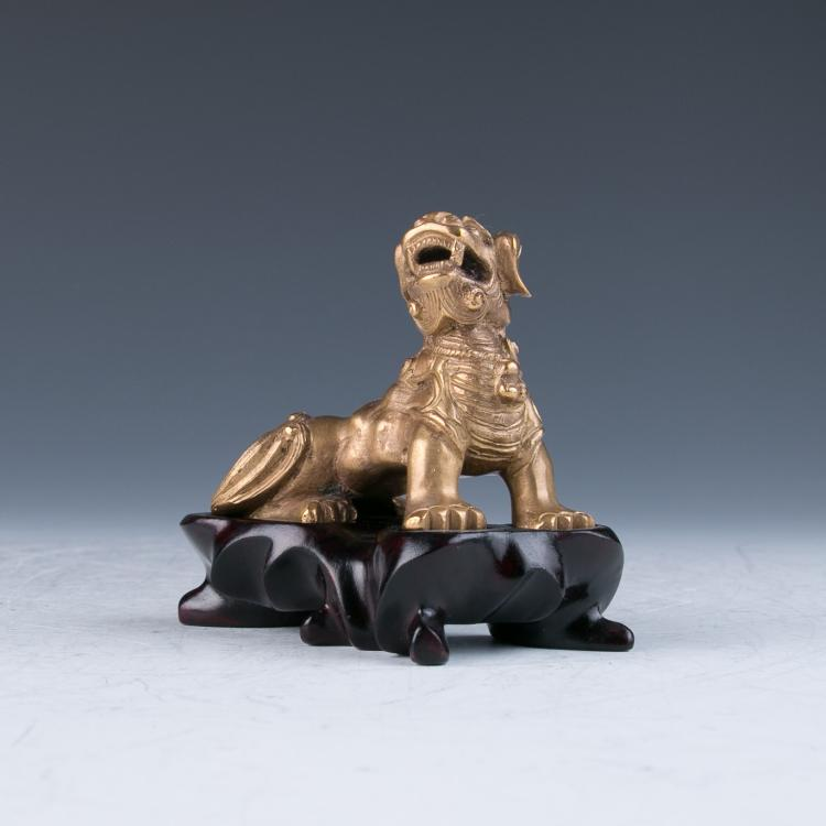 A Gilt Bronze Lion with a Fitted Stand