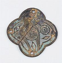 A gilded copper appliqué figure originally from a cross.  Champlevé enamel residue.  Limoges. France.  13th century.