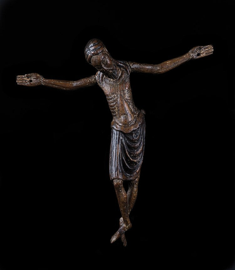 Carved wooden crucified Christ with slight stucco and polychrome residue.