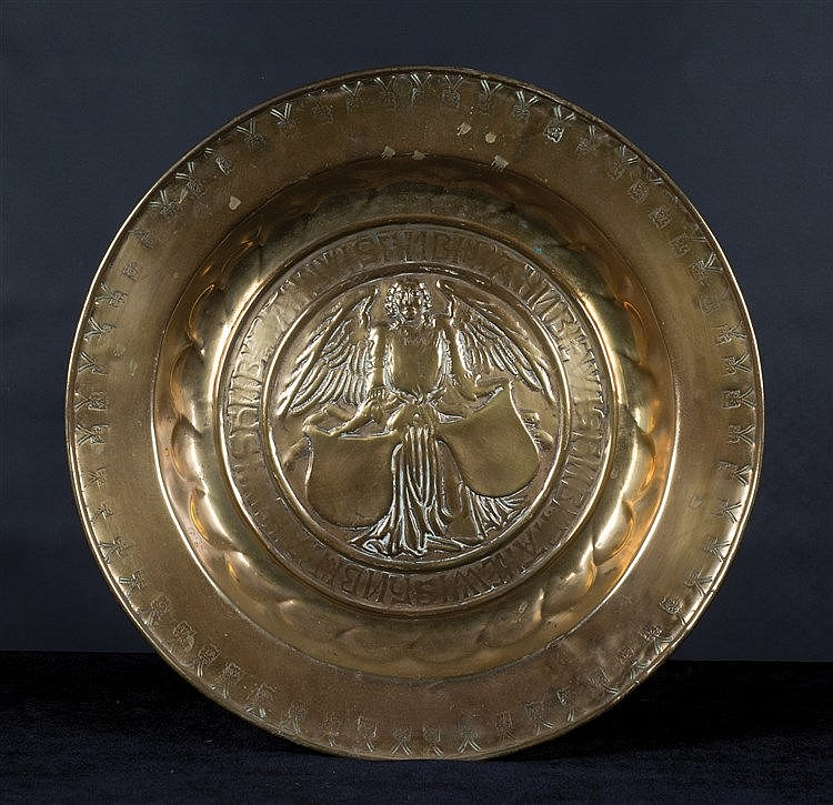 A brass alm dish. German. Nuremberg. Circa 1550. The centre is decor